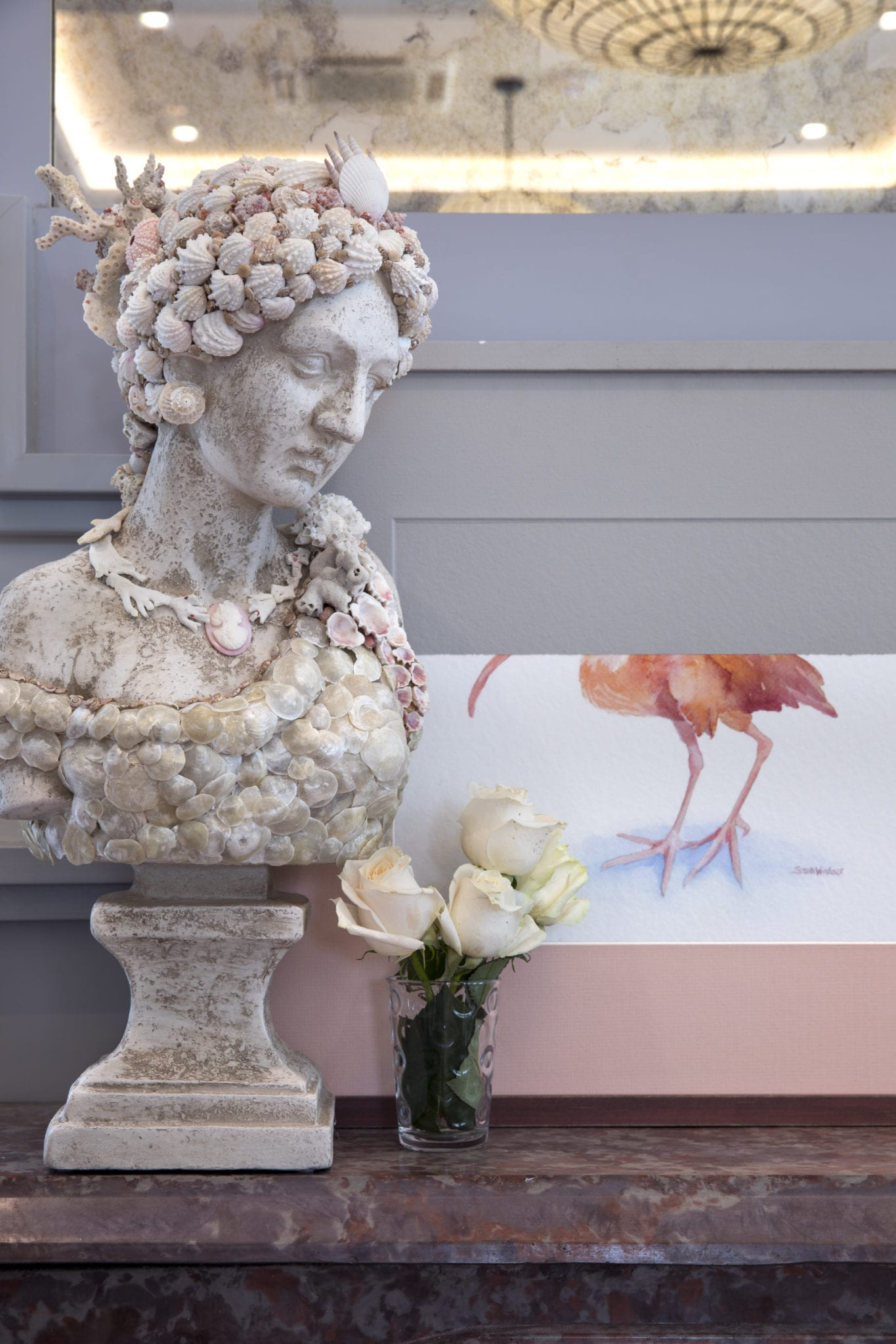 Grecian bust and flowers.
